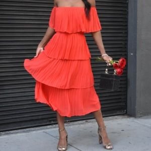 Red off the shoulder tiered midi dress with pleats
